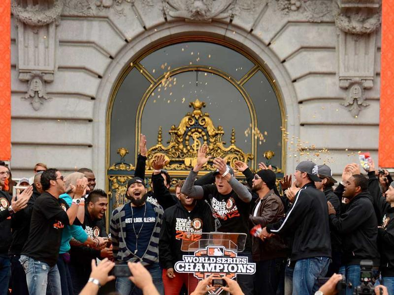 San Francisco Giants Hunter Pences and the rest of the Giants rally together on stage for the fans during the Giants' victory parade and celebration in San Francisco, California. AFP/Thearon W Henderson