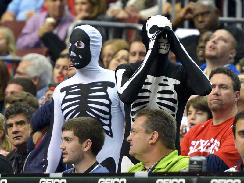 A couple of fans dressed for Halloween react during the game between the Denver Nuggets and Philadelphia 76ers at the Wells Fargo Center in Philadelphia, Pennsylvania. AFP/Drew Hallowell