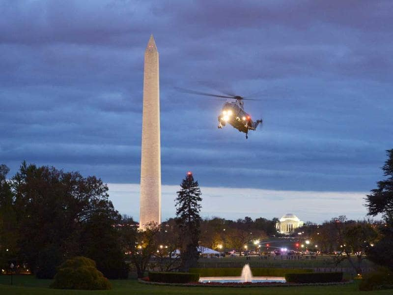 Marine One, carrying US President Barack Obama, approaches to land on the South Lawn of the White House in Washington, DC. Obama was returning from a visit to hurricane stricken New Jersey. AFP/Mandel Ngan