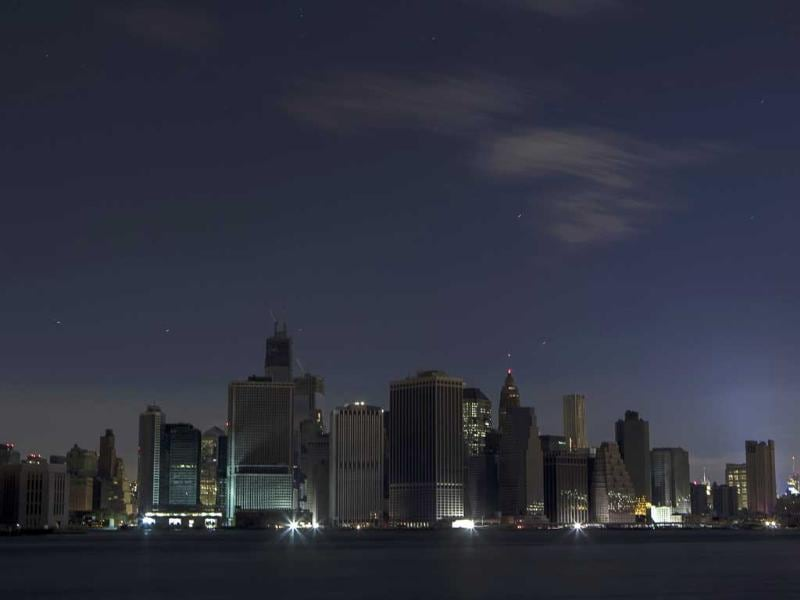 A largely powerless downtown Manhattan stands under a night sky due to a power blackout caused by Hurricane Sandy in New York. Reuters/Lucas Jackson