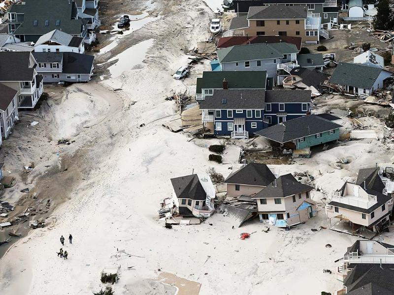 Rescue workers walk past homes wrecked by Superstorm Sandy in Seaside Heights, New Jersey. AFP Photo/Mario Tama