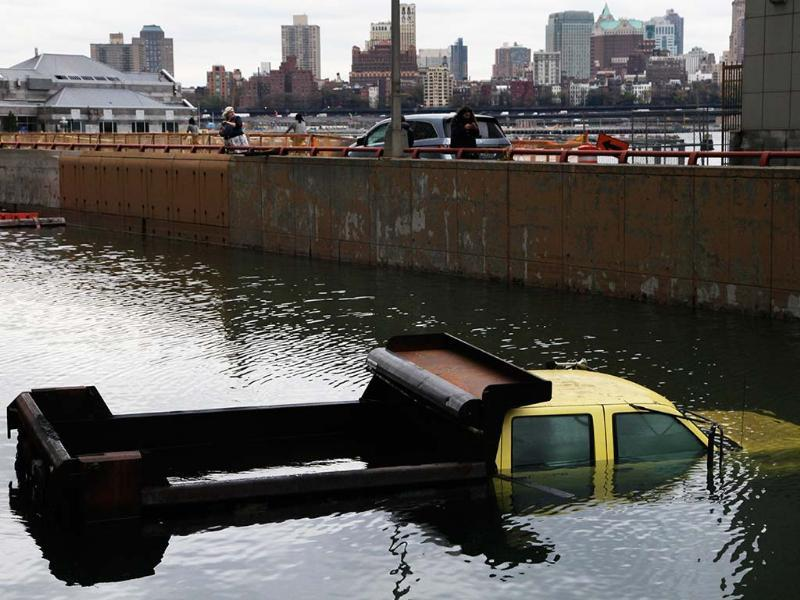A truck from the New York City Department of Transportation is submerged at the entrance to the Battery Park Underpass in lower Manhattan. AP Photo/Mark Lennihan
