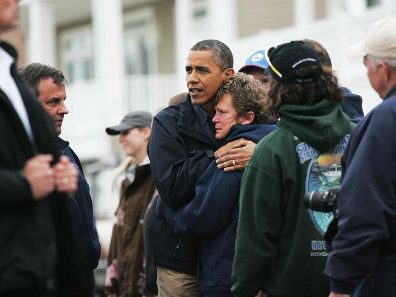 President Barack Obama embraces Donna Vanzant during a tour of a neighborhood effected by superstorm Sandy in Brigantine. Vanzant is an owner of North Point Marina, which was damaged by the storm. AP Photo/Kevin R. Wexler