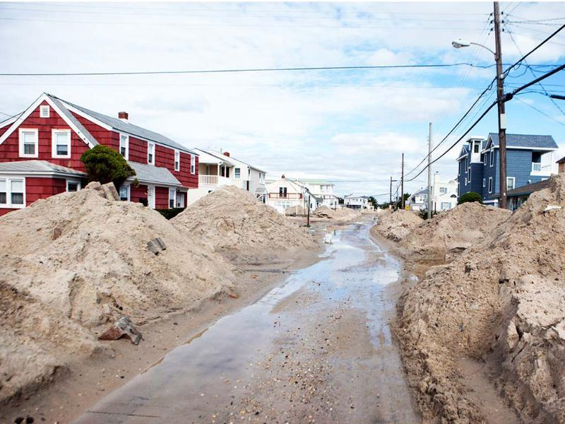 Sand is piles high along a plowed street in Beach Haven on Long Beach Island, New.Jersey. AP Photo/Ed Hille