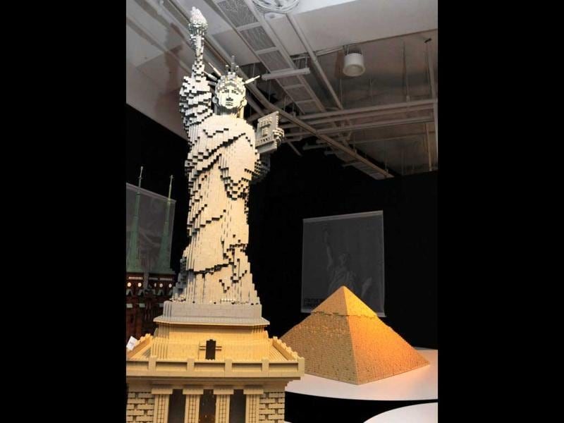 United States' Statue of Liberty (L) and Egypt's Pyramid, made of pieces of Lego blocks, are displayed at a press preview in Tokyo. Forty World Heritage architectures are displayed at an exhibition