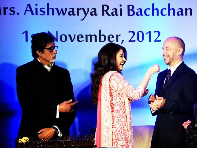 Aishwarya Rai Bachchan offers her birthday cake to the French ambassador to India, Francois Richier. (AFP Photo)