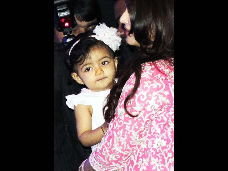Aishwarya Rai Bachchan's daughter Aaradhya poses for the photogs. Isn't she cute? (AFP Photo)