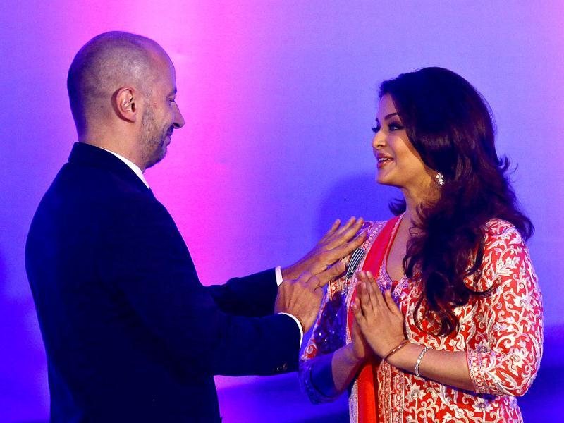 Ambassador of France to India, Francois Richier pins the second highest French civilian award Officer Dan Ordre Arts et des Lettres onto Bollywood actress Aishwarya Rai Bachchan. (AP Photo)