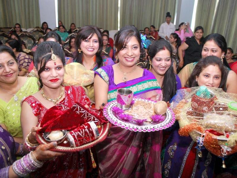 Women participate in a competition and also perform rituals on the occasion of Karva Chauth in Amritsar. Agencies