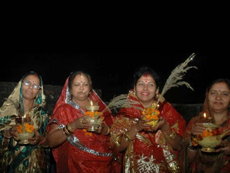 Women offer prayers on the occasion of Karva Chauth festival for long life of their husband in Lucknow. Agencies