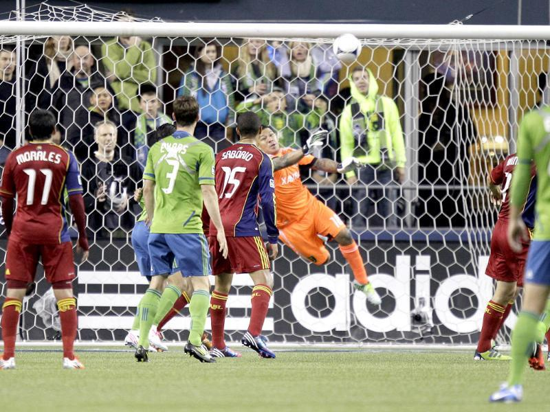 Real Salt Lake goalkeeper Nick Rimando makes a save against the Seattle Sounders in the first half of an MLS soccer match in Seattle. AP/Ted S Warren
