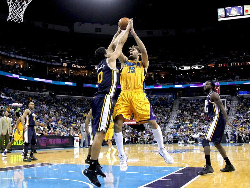New Orleans Hornets center Robin Lopez goes to the basket against Utah Jazz center Enes Kanter during the second half of an NBA basketball game in New Orleans. AP/Jonathan Bachman