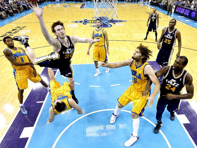 Utah Jazz shooting guard Gordon Hayward shoots the ball over New Orleans Hornets power forward Ryan Anderson during the second half of an NBA basketball game in New Orleans. AP/Jonathan Bachman