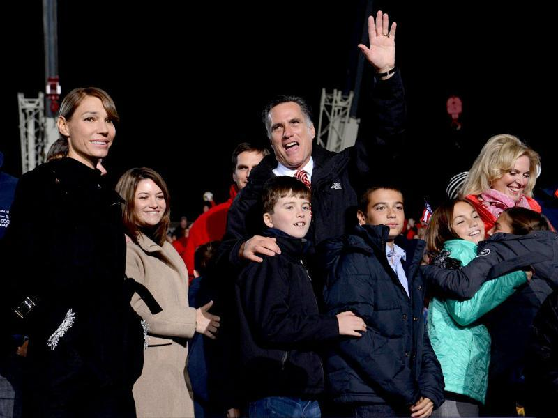 US Republican Presidential candidate Mitt Romney and his wife Ann with family members wave at a rally at Union Center in West Chester, Ohio. AFP/Emmanuel Dunand