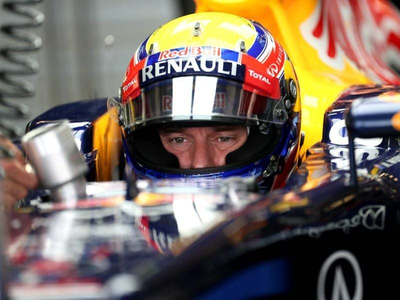 Red Bull Racing's Australian driver Mark Webber sits in the pits during the third practice session at the Yas Marina circuit in Abu Dhabi ahead of the Abu Dhabi Formula One Grand Prix. AFP Photo