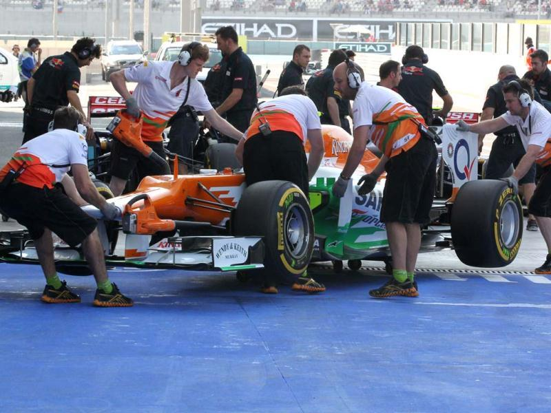 Mechanics push the car of Force India's German driver Nico Hulkenberg in the pits during the third practice session at the Yas Marina circuit in Abu Dhabi ahead of the Abu Dhabi Formula One Grand Prix. AFP Photo