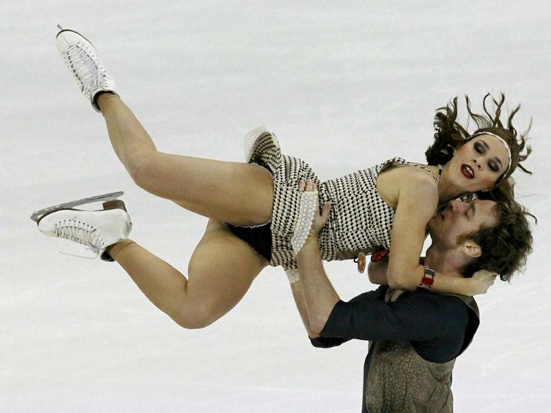 Nathalie Pechalat and Fabian Bourzat of France perform during the Ice Dancing Short Dance at the ISU Grand Prix of Figure Skating Cup of China Figure Skating competition in Shanghai. AP photo