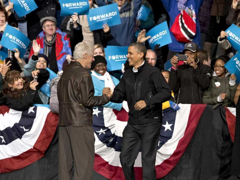 In the final hours of a four-state campaign day, President Barack Obama is joined by former President Bill Clinton at a rally at Jiffy Lube Live arena in Bristow. Virginia is one of the most closely contested battleground states. AP /J Scott Applewhite