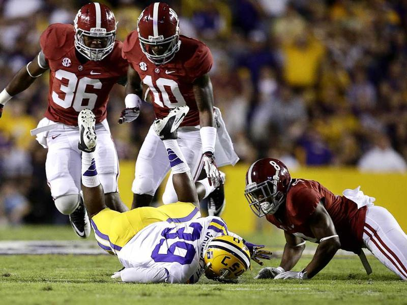 LSU safety Jerqwinick Sandolph recovers a fumbled punt return by Alabama wide receiver Cyrus Jones as linebacker Tyler Hayes and defensive back John Fulton cover in the first half of their NCAA college football game in Baton Rouge, La. AP/Bill Haber