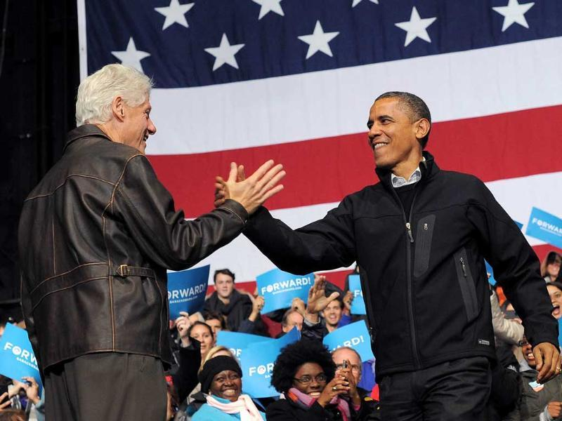 US President Barack Obama is greeted by former president Bill Clinton during a campaign at Jiffy Lube Live in Bristow, Virginia. AFP/Jewel Samad