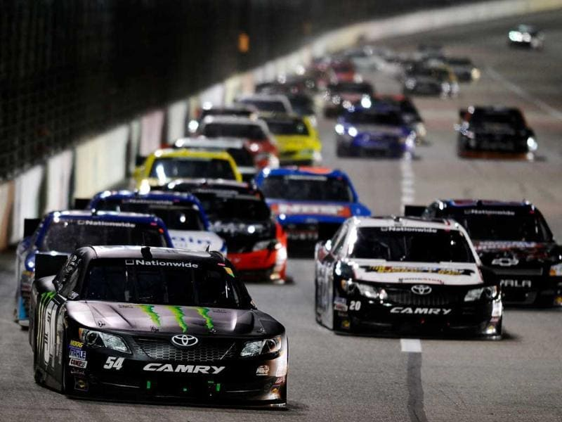 Kyle Busch, driver of the Monster Energy Toyota, leads the field during the NASCAR Nationwide Series O'Reilly Auto Parts Challenge at Texas Motor Speedway in Fort Worth, Texas. AFP/Jared C Tilton