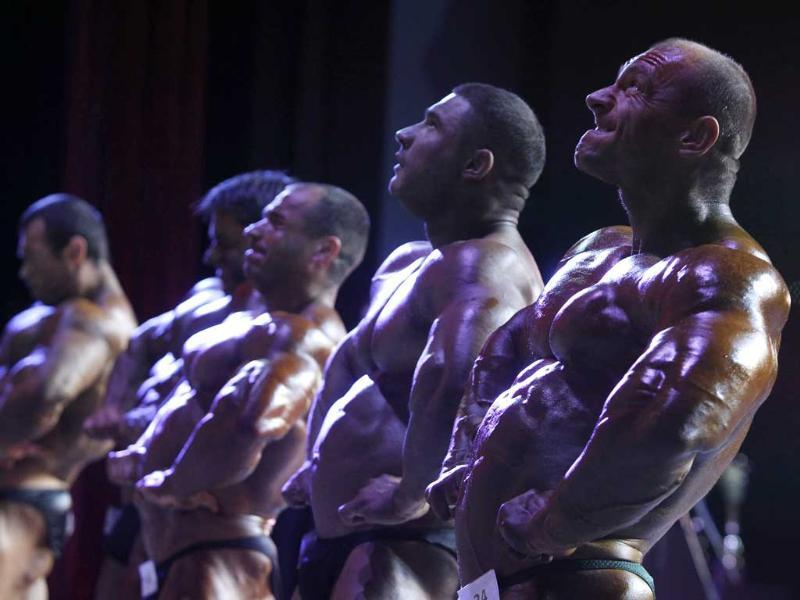 Participant compete during the international bodybuilding tournament