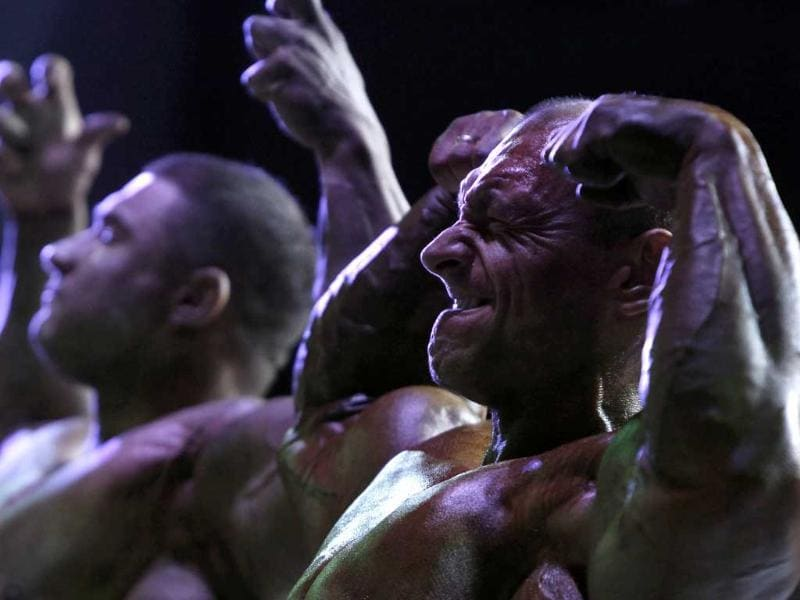 Participants compete during the international bodybuilding tournament