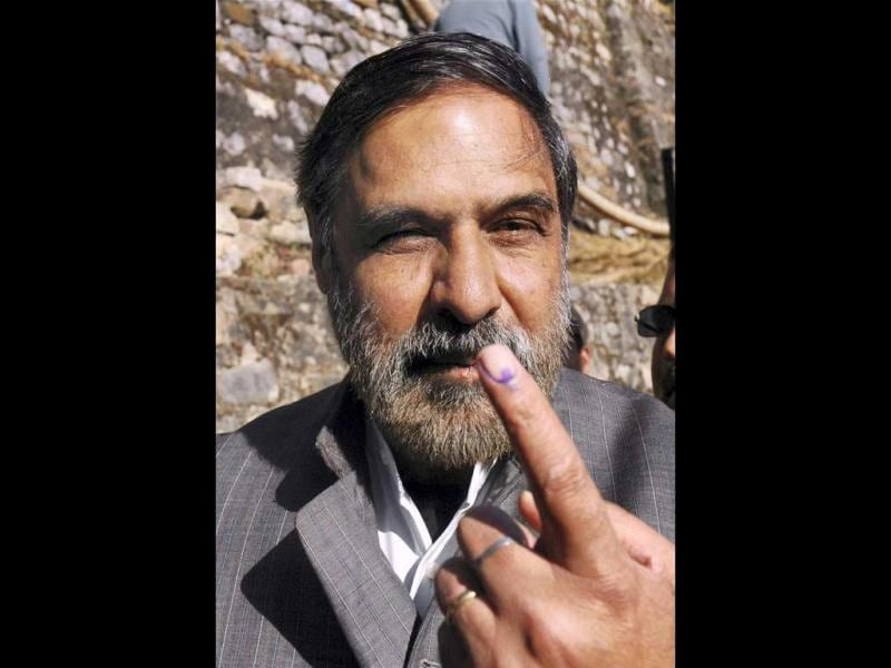 Union minister for commerce and industry Anand Sharma shows his marked finger after casting his vote for the Himachal Pradesh assembly elections at a polling booth in Shimla. PTI