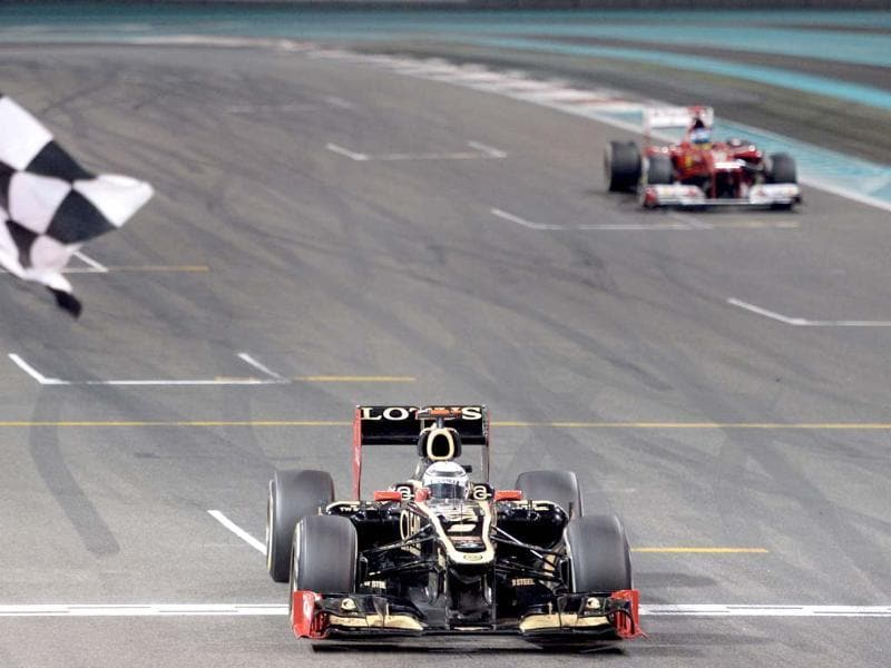Lotus F1 Team's Finnish driver Kimi Raikkonen wins ahead of Ferrari's Spanish driver Fernando Alonso at the Yas Marina circuit in Abu Dhabi after the Abu Dhabi Formula One Grand Prix. AFP