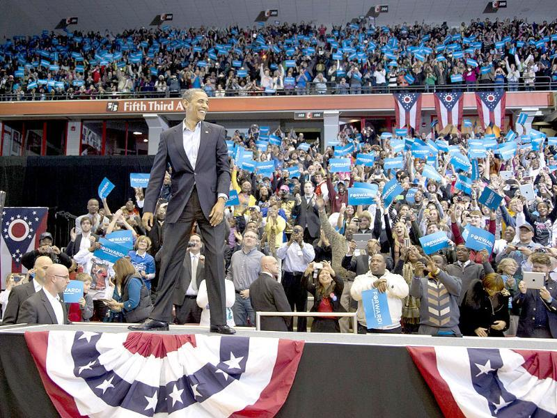 President Barack Obama arrives to a cheering crowd at a campaign event at the Fifth Third Arena on the University of Cincinnati campus in Cincinnati. AP/Carolyn Kaster