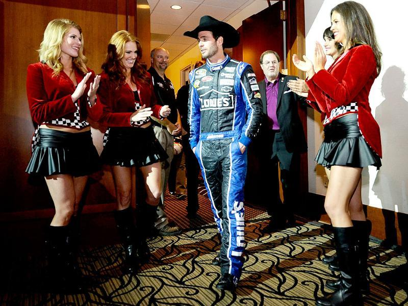 Jimmie Johnson, driver of the Lowe's Chevrolet, is introduced with The Great American Sweethearts during the victory champagne toast in The Speedway Club after winning the NASCAR Sprint Cup Series AAA Texas 500 at Texas Motor Speedway in Fort Worth, Texas. AFP/Jared C Tilton