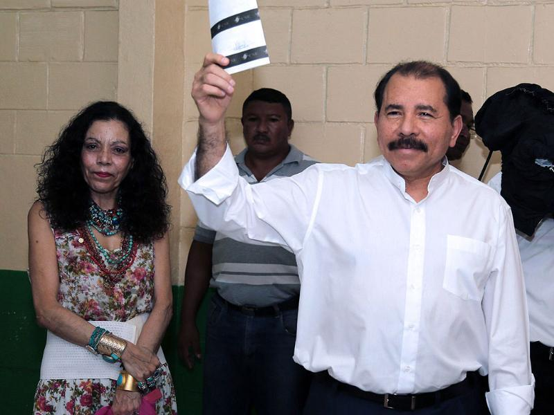 Nicaraguan President Daniel Ortega, voting during municipal elections, accompanied by his wife, Rosario Murillo, in Managua. Nicaraguans vote to elect 153 municipal mayors, 153 vice-mayors and 6076 councilors. AFP/Nicaraguan Presidency-Cesar Perez
