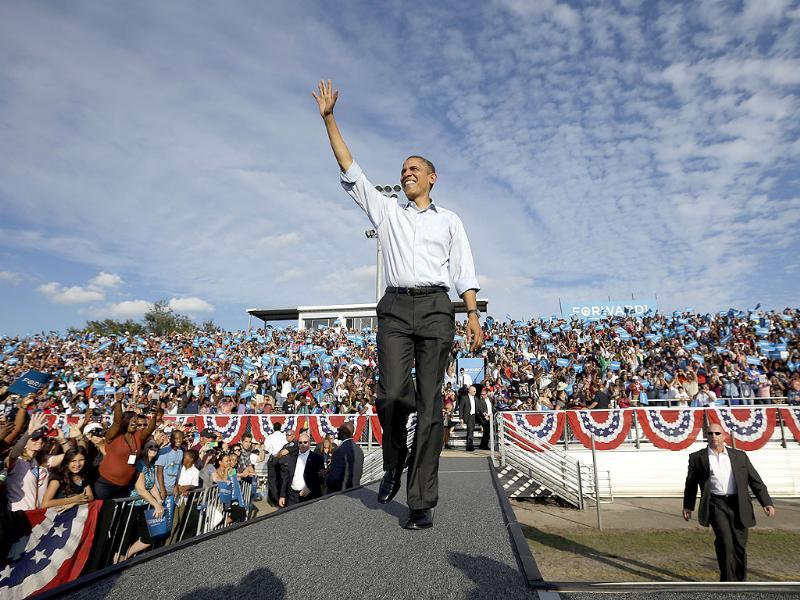 President Barack Obama waves as he is introduced before speaking to supporters during a campaign event at McArthur High School in Hollywood, Fla. AP/Pablo Martinez Monsivais