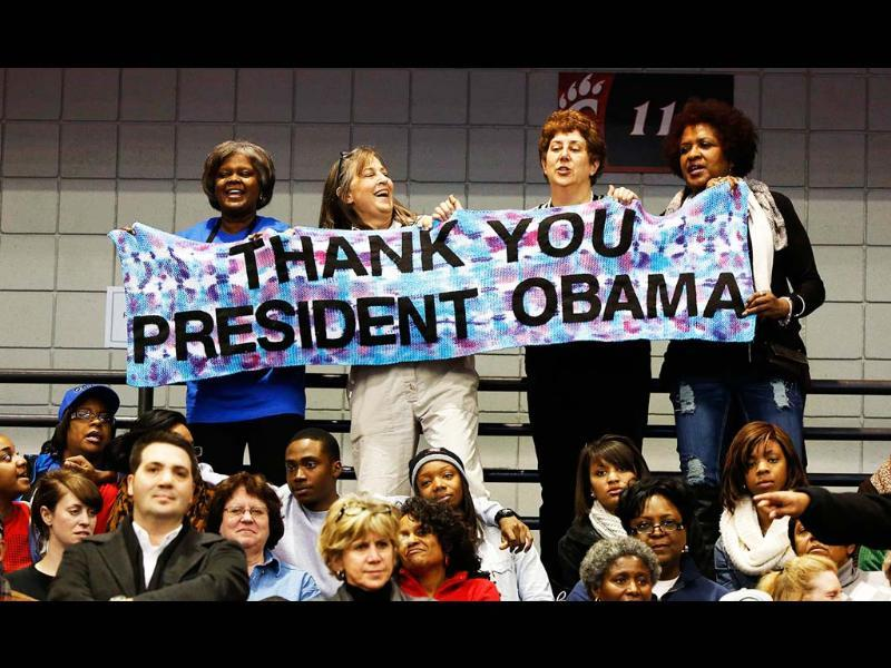 Supporters hold a sign as US President Barack Obama speaks at a campaign event at Fifth Third Arena at the University of Cincinnati. Reuters/Larry Downing