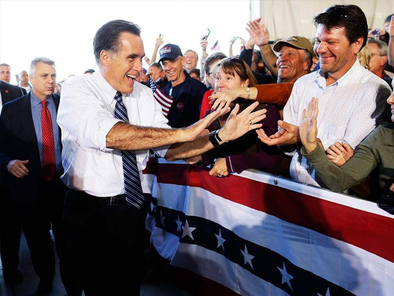 Republican presidential candidate Mitt Romney high fives supporters as he campaigns at Colorado Springs Municipal Airport in Colorado Springs, Col. AP/Charles Dharapak