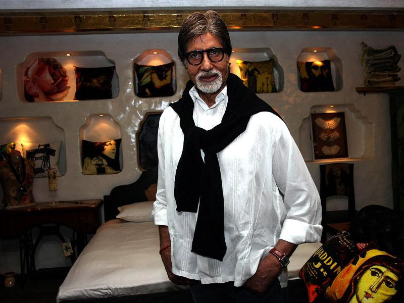 Big B poses in front of the art pieces on display at an exhibition in Mumbai.