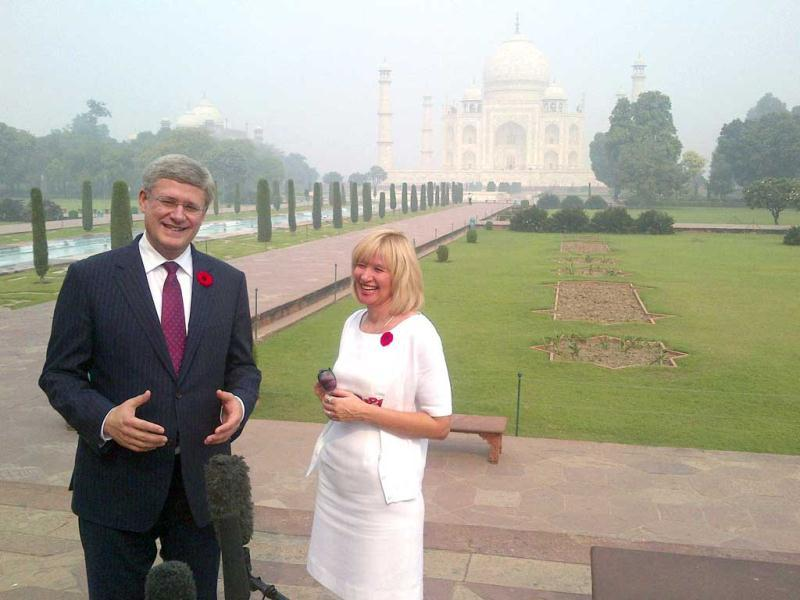 Canadian Prime Minister Stephen Harper (L) and his wife Laureen share a light moment while speaking with the media during their visit to the historic Taj Mahal in Agra. Reuters/Randall Palmer