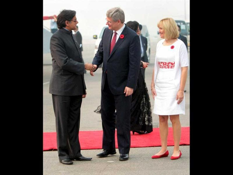 Canadian Prime Minister Stephen Harper being welcomed by Shashi Tharoor, Minister of State for HRD on his arrival at AFS Palam in New Delhi. Harper's wife Laureen is also seen. PTI Photo/Subhav Shukla