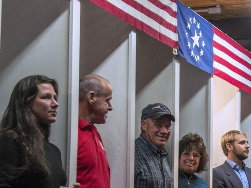 People prepare to cast their ballots inside polling booths just after midnight in Dixville Notch, New hampshire, the very first voting to take place in the 2012 US presidential election. AFP/Rogerio Barbosa