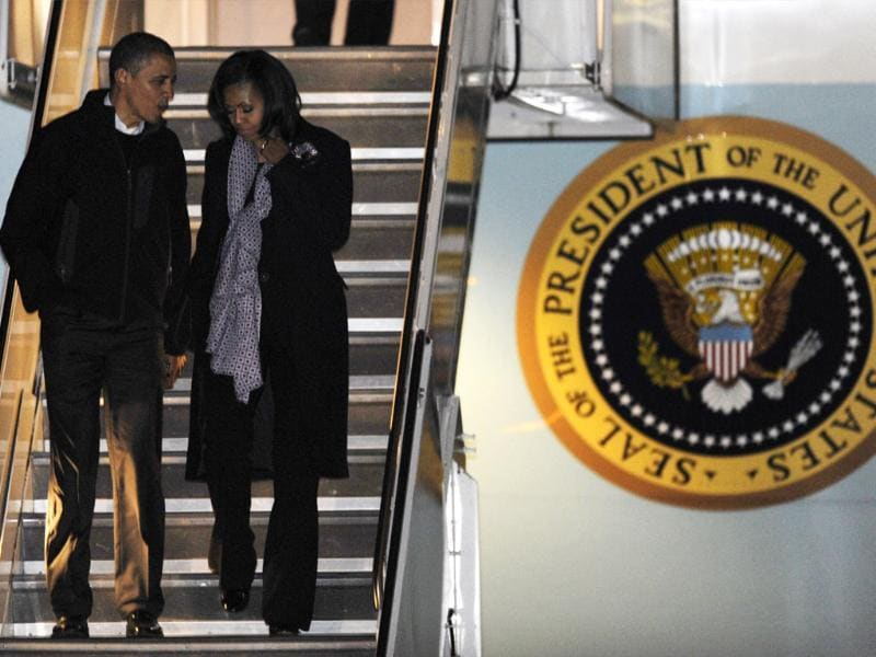 President Barack Obama and first lady Michelle Obama walk off Air Force One after arriving at O'Hare International Airport in Chicago. AP/Paul Beaty