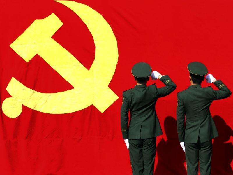 Paramilitary policemen hold their fists in front of a flag of Communist Party of China as they attend an oath-taking rally to ensure the safety of the upcoming 18th National Congress of the Communist Party of China (CPC), Zhejiang province. Reuters Photo