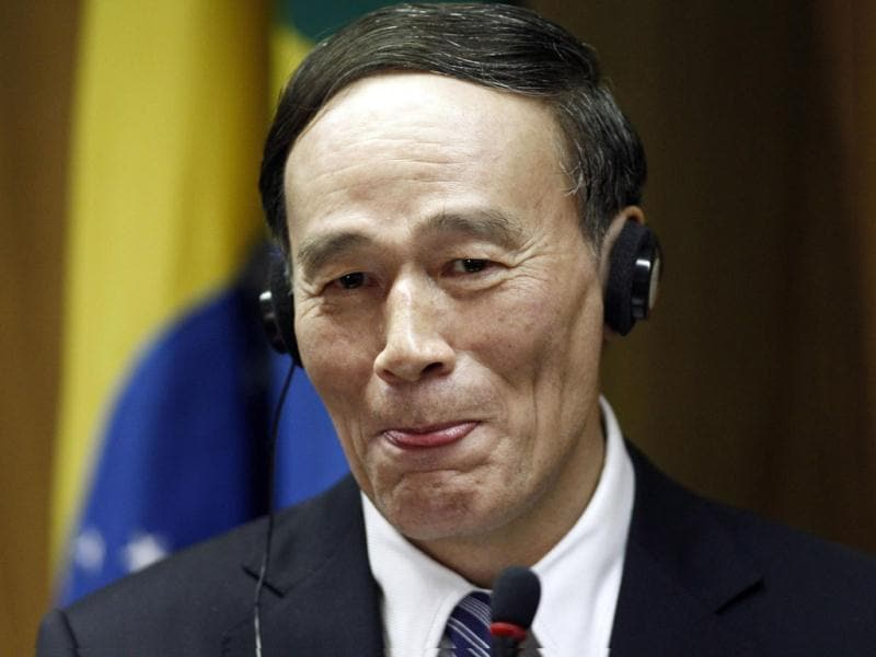 Wang Qishan, China's vice premier, attends a news conference after meeting with Brazil's Vice President Michel Temer at the Itamaraty Palace in Brasilia. Reuters file photo