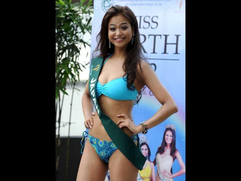 Megumi Noda of Japan poses for photographers during a press presentation of the Miss Earth beauty pageant at a hotel in Manila. (AFP Photo)