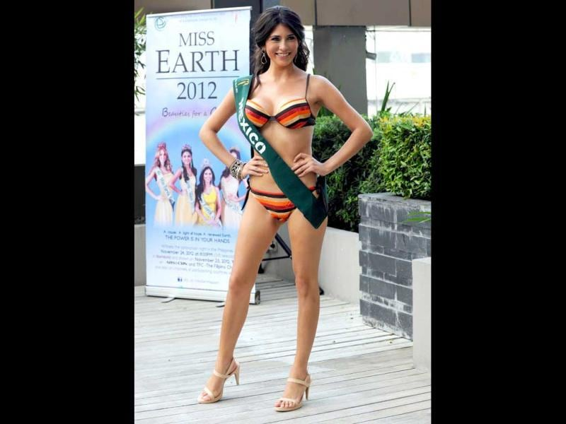 Lourdes Paola Aguilar of Mexico poses for photographers during a press presentation of the Miss Earth beauty pageant at a hotel in Manila. (AFP Photo)