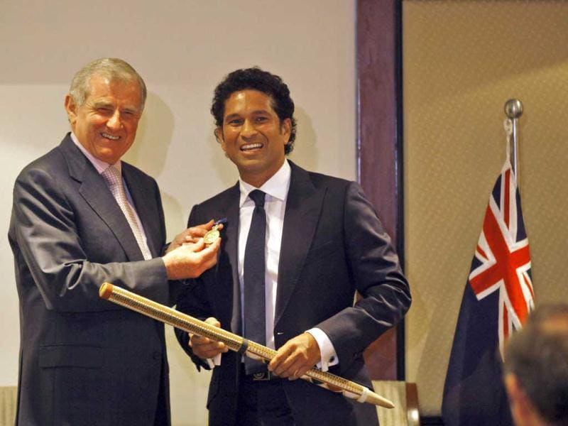 Minister for Regional Australia and Minister for the Arts Simon Crean displays the Order of Australia conferred upon Sachin Tendulkar during an event in Mumbai. AP Photo