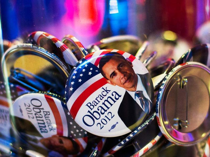 Buttons with portraits of US President Barack Obama lie in a glass bowl during the US election night at the representation of the Bertelsmann media cooperation in Berlin. Reuters