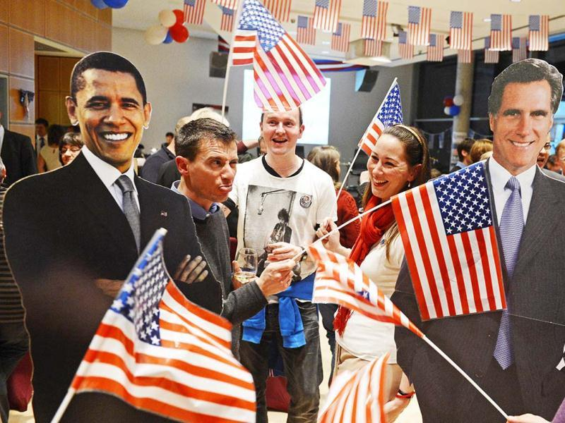 Americans and Germans celebrate with flags around cardboard figures of US president Barack Obama and Republican presidential candidate, former Massachusetts Gov. Mitt Romney during the 'Election Party' organized by the US consulate Leipzig to wait for the results of the 2012 in Leipzig, central Germany. AP Photo