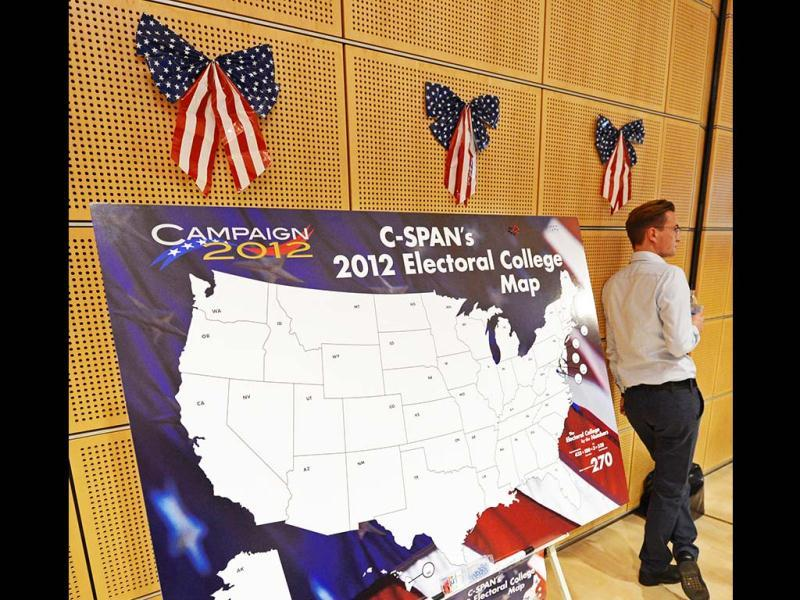 A man stands besides a US map during the 'Election Party' organized by the US consulate Leipzig to wait for the results of the 2012 in Leipzig, central Germany. AP Photo