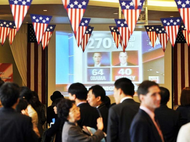 Visitors watch a big screen showing a live broadcast of the US election during a '2012 US Election Watch' event organized by the US embassy in Seoul. AFP photo