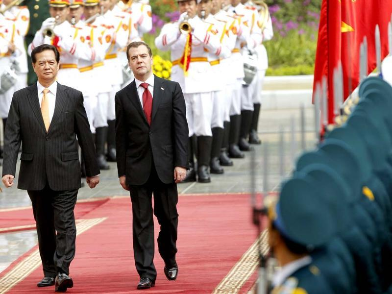 Russia's prime minister Dmitry Medvedev (R) reviews the guard of honour with his Vietnamese counterpart Nguyen Tan Dung during a welcoming ceremony at the Presidential Palace in Hanoi. Medvedev is in Hanoi on a two-day visit to Vietnam. REUTERS/Kham